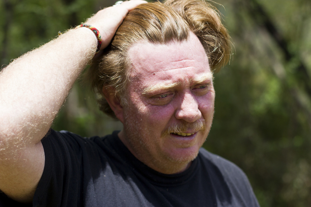 Virgil Edwards pushes his hair back after working for several hours in the heat and humidity of Chiapas, Mexico. Almost every day he prunes up to 10 trees, and he has a goal of planting 1,500 trees to make up for the ones he lost.