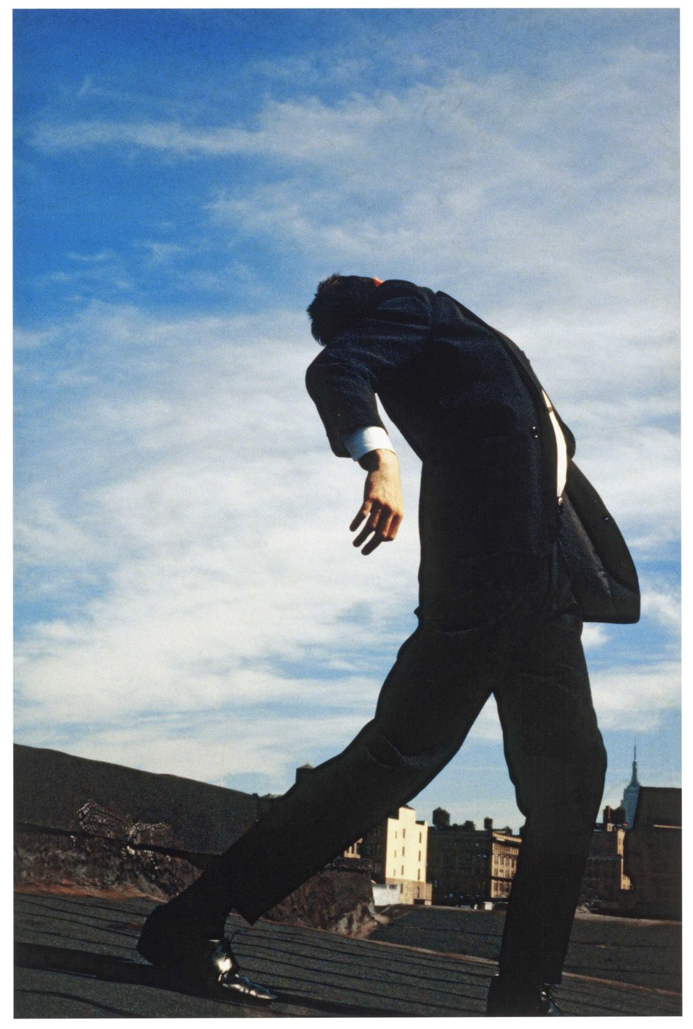 "3. ""Men in the city"" - Robert Longo -  Corresponding song: Dancing on the Roof"