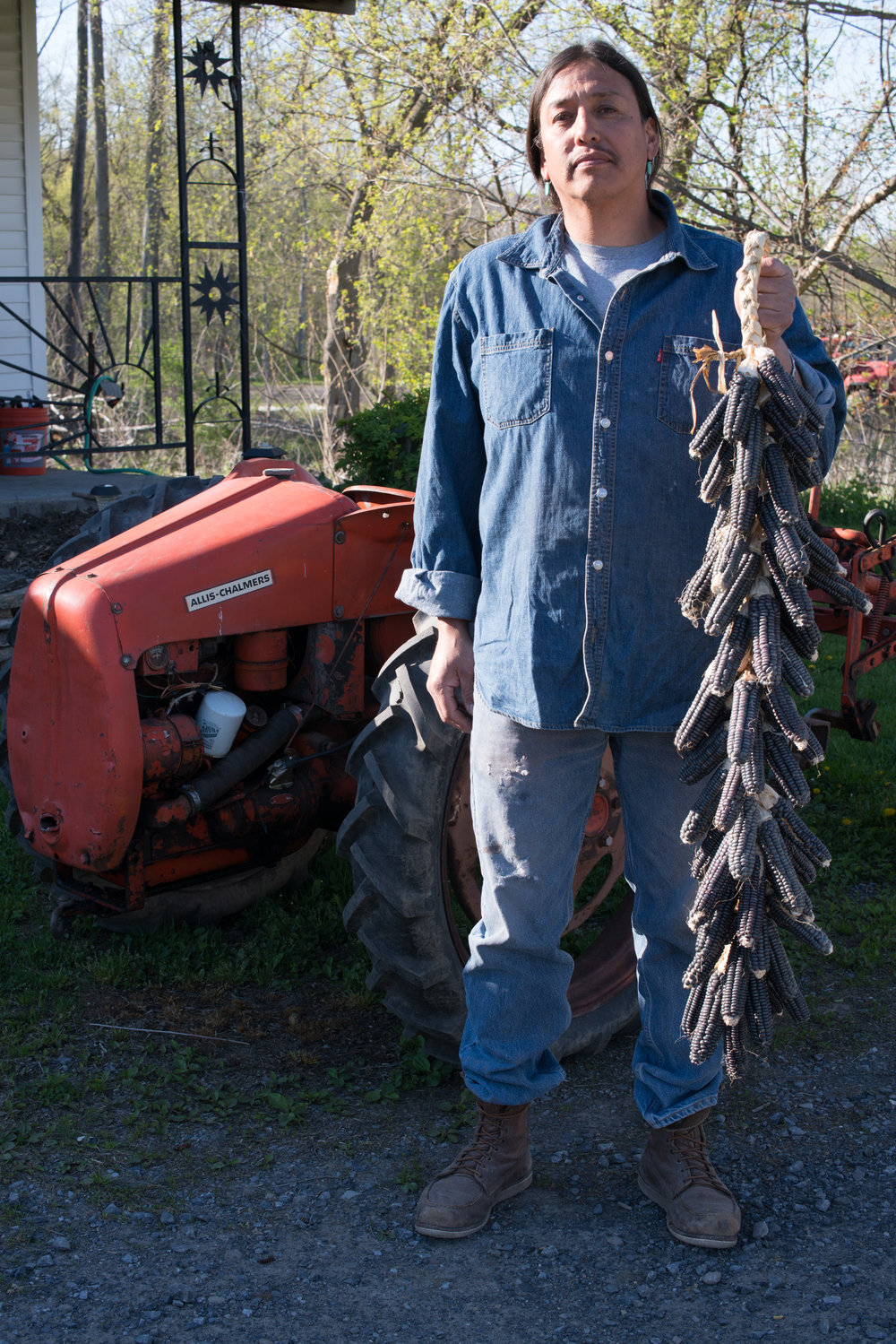"Roger Cook, Mohawk  ""I've been planting since a young child. My purpose is to keep the corn seed alive to pass it on. We are the seed bank. Our old people held onto the seeds and kept them going. In my heart, the people who plant are the ones we need to listen to. Not the ones who leave and come back and want to see the harvest.""  (Photo credit: Mateo Hinojosa)"