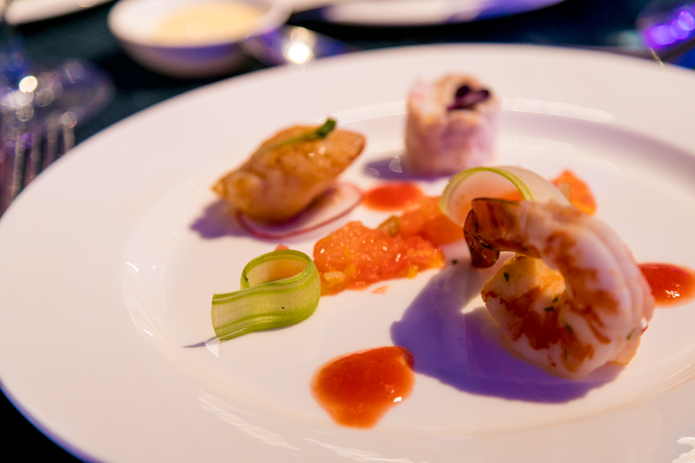 Grilled scallop, poached tiger prawn, lump crab meat tian, citrus salad and a touch of gazpacho dressing