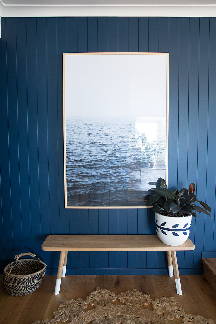 The artwork 'Ocean Breeze'by  The Art & Framing Company positioned on the landing sets the tone for a contemporary, calming zone.