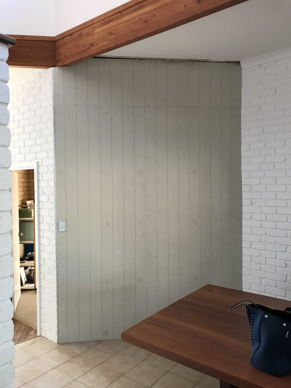 ...and the cladding installation (pre painting) creates a feature and interest in the space and gives a subtle nod to the beachside location.