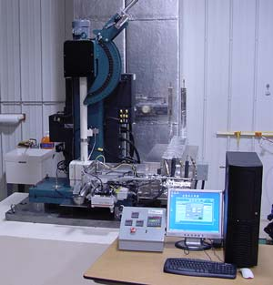 MPM Automatic System Installed on a 400-ft-lb-U-Hammer Machine for Hot Cell Testing