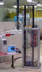 Figure 1 - MPM Tower Configured for ASTM D3763 Puncture Test