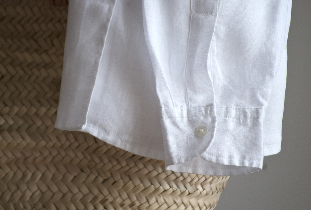 Soft linen shirting in plain white, black and natural. Also available in stripes and checks