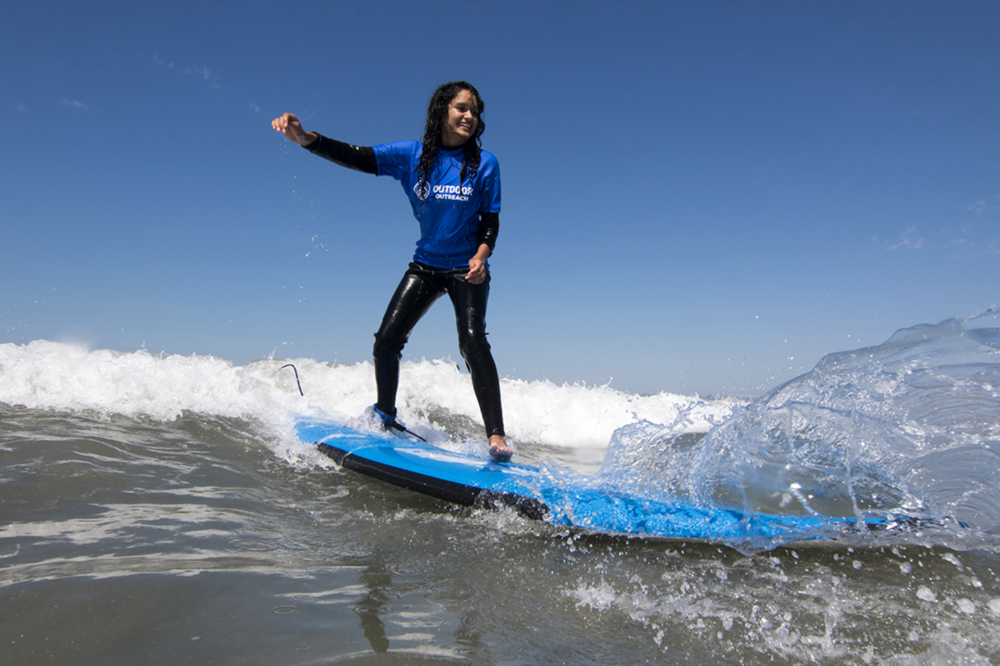 Teaching kids to surf with Outdoor Outreach.
