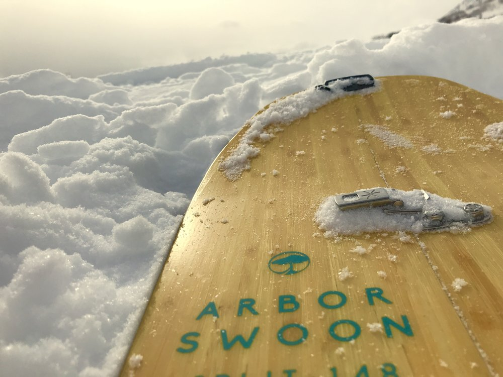If you're a snowboarder, accessing the backcountry can be challenging, but a splitboard allows you to split the board in half and hike up with skins, just like a skier.