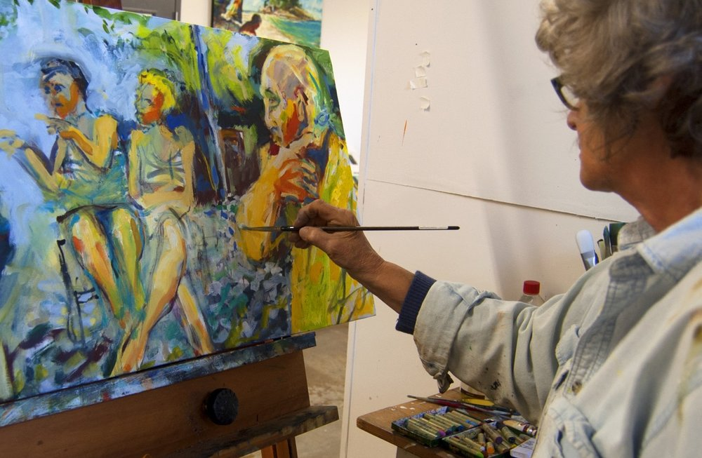 Louise FArley painting in her studio at clearwater artist studios
