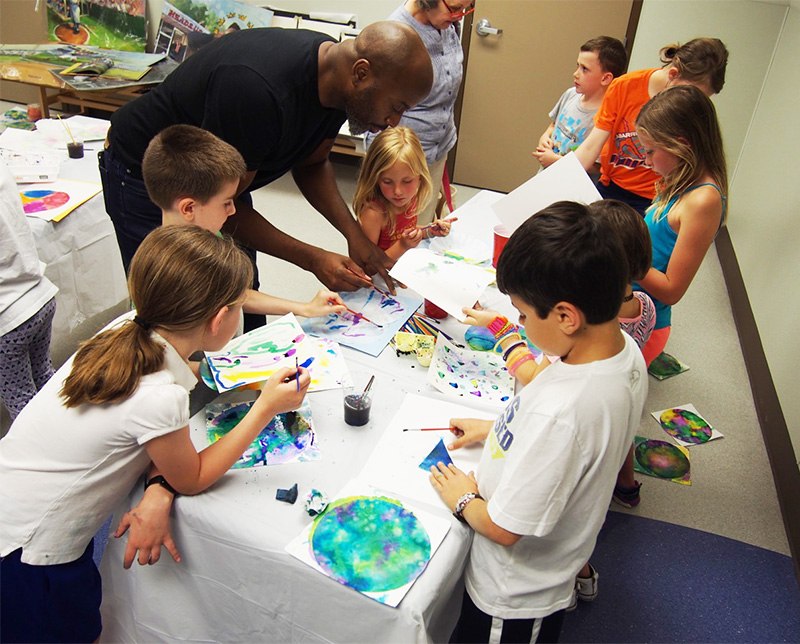 Clearwater Artist Gordon C. James leads kids in a Public Library Event for N.C. Science Fest Week, April 2017