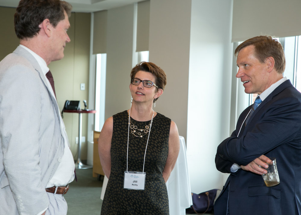 Michael K. Loucks (left) with Jill Reilly and Murphy