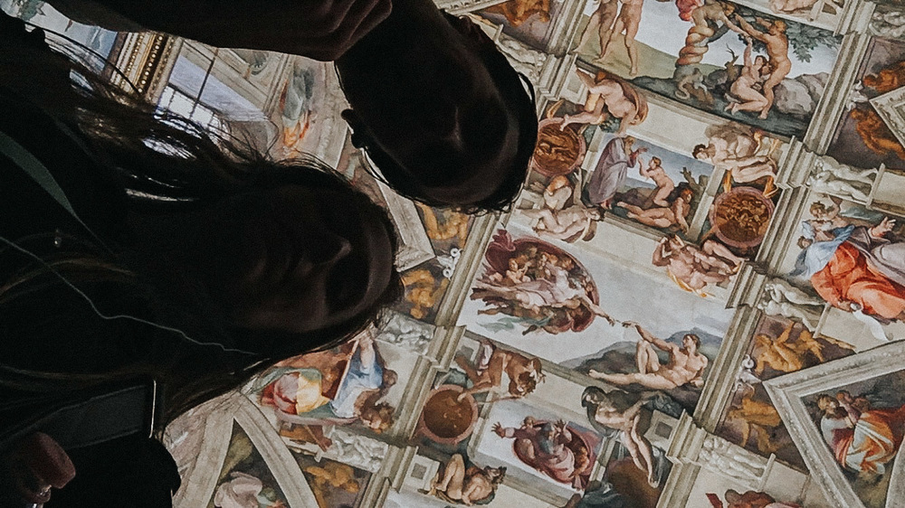 Shawn and sara sneak a picture of the sistine chapel // The Creation of adam is directly above