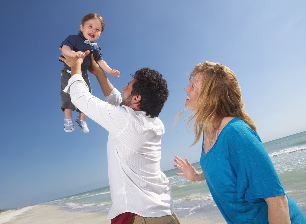 blue-sky-baby-holding-up-beach-portrait-florida.jpg