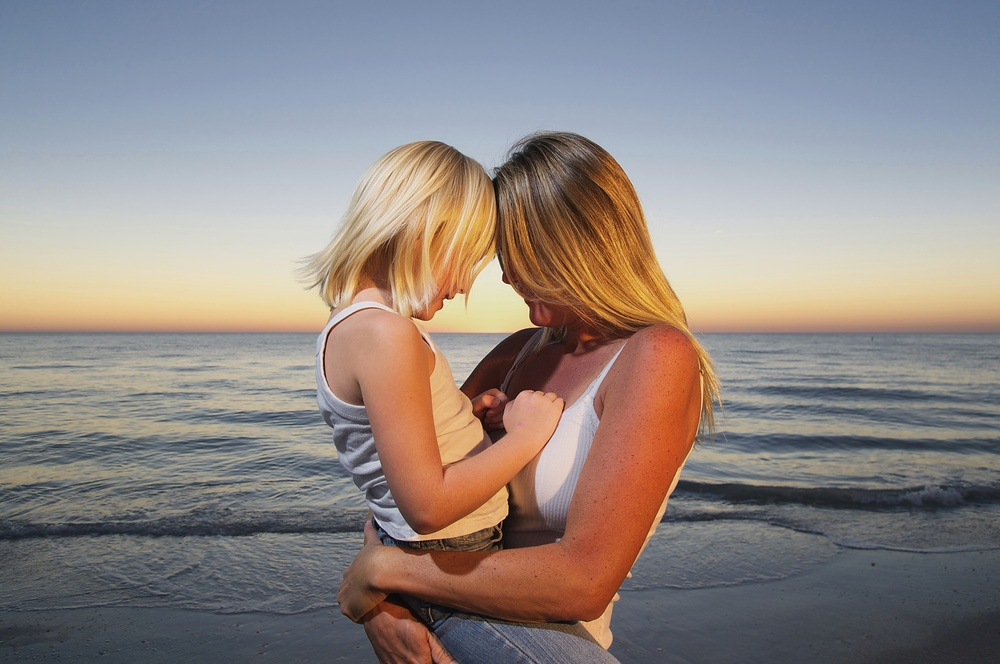 mother-daughter-tender-florida-beach-portrait.jpg