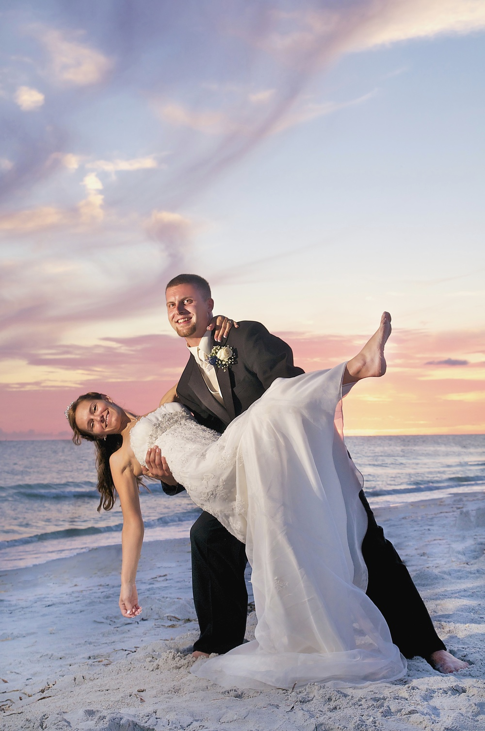 bride-groom-dip-beach-wedding-portrait-florida.jpg