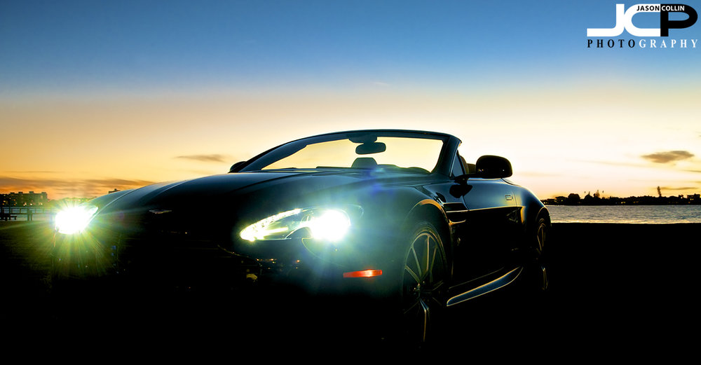 Aston Martin V8 Vantage Roadster shining its lights as twilight falls over Tampa Bay - Nikon D300 Tamron 17-50mm @ f/8 1 sec ISO 200 tripod mounted