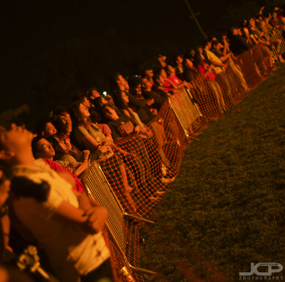 UNM students look on illuminated by fire at the Red Rally 2017 - Nikon D750 with Nikkor 50mm @ f/2 1/60th ISO 1250