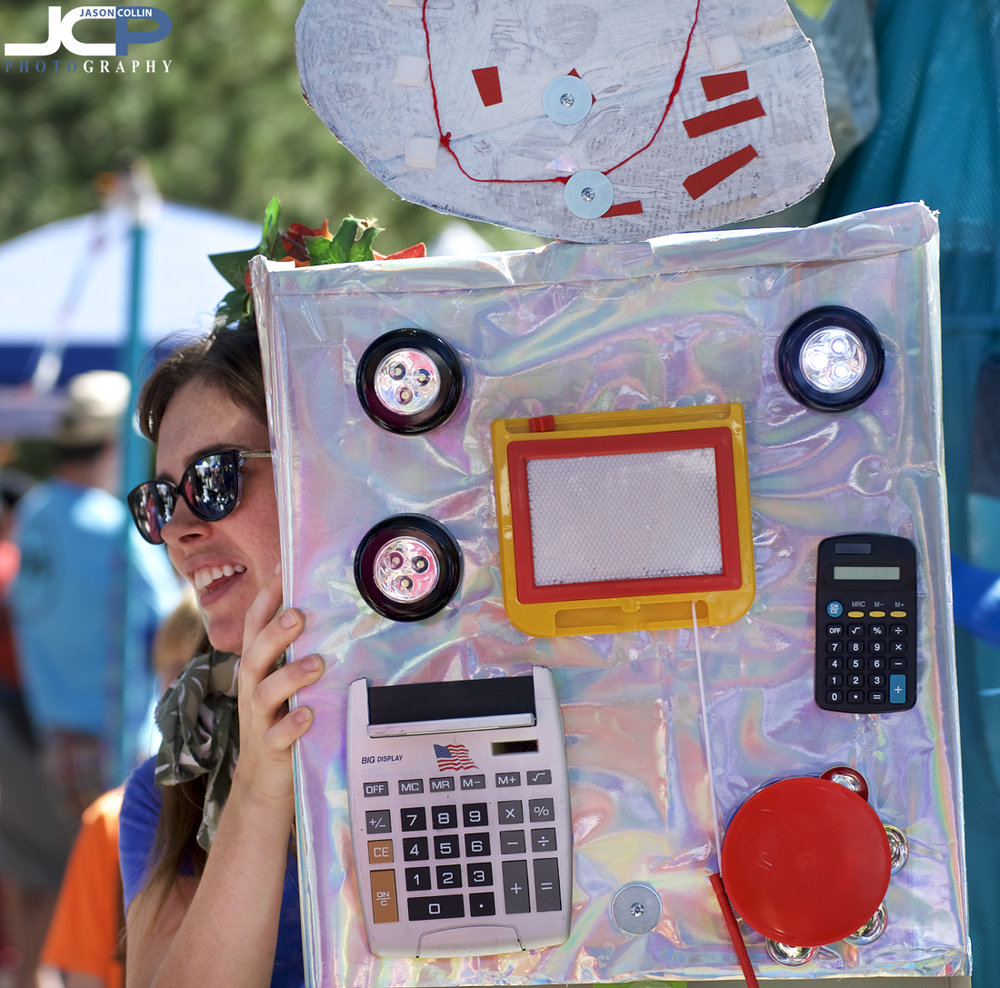 Getting creative with a robot puppet at 15th Offcenter Folk Art Festival in Albuquerque, NM - Nikon D750 with Nikkor 80-200mm f/2.8D @ f/4 1/320th ISO 100