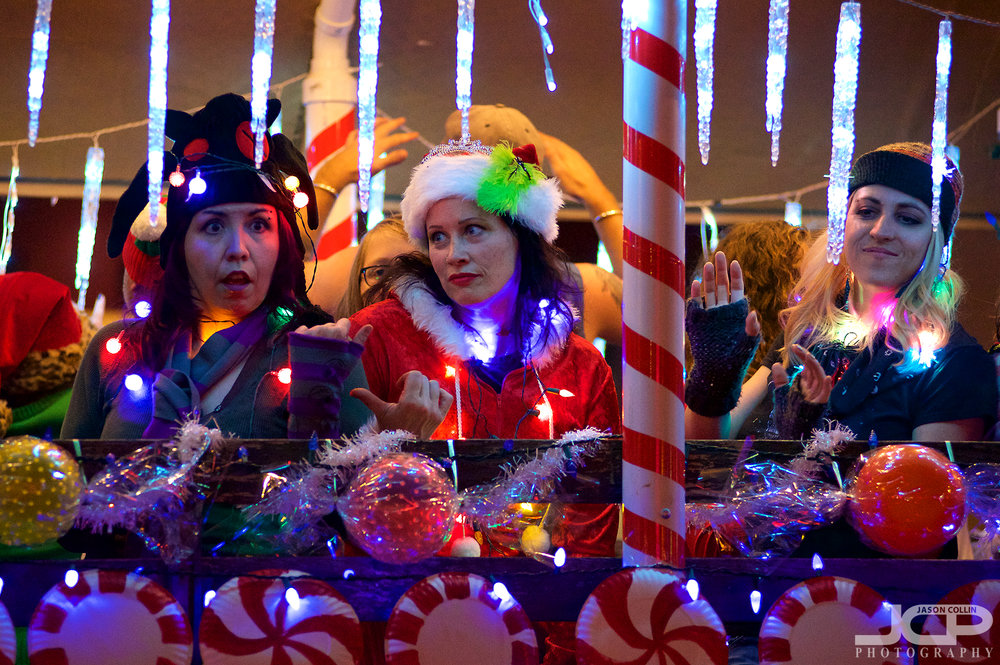 I love the very different expressions on each woman's face as they sing and dance on this float! - Nikon D750 with Nikkor 80-200mm f/2.8D @ f/2.8 1/200th ISO 4000