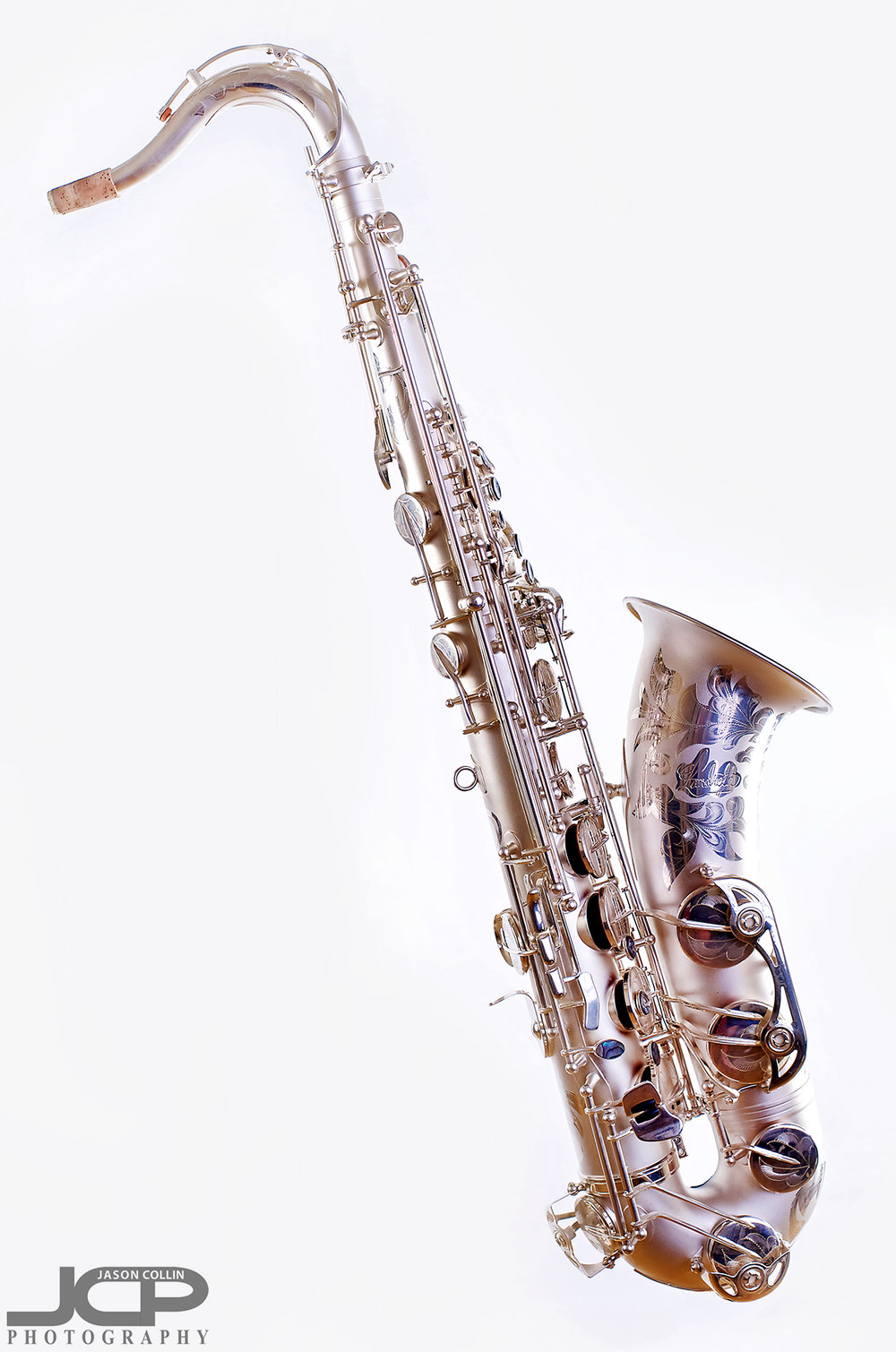 """Profile view of this saxophone with stand digitally removed -Nikon D750 with Nikkor 50mm f/1.8G lens @ f/8 1/160th ISO 100 - Strobist: Westcott Strobe Light Plus in 55"""" octagon gridded soft box main with two 43"""" shoot through umbrellas with speedlights on the white muslin background"""