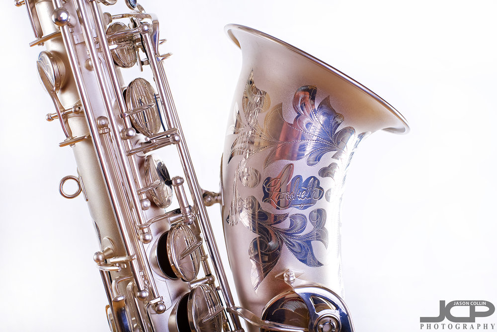 """Very detailed etching on this saxophone I photographed in Albuquerque -Nikon D750 with Nikkor 50mm f/1.8G lens @ f/8 1/160th ISO 100 - Strobist: Westcott Strobe Light Plus in 55"""" octagon gridded soft box main with two 43"""" shoot through umbrellas with speedlights on the white muslin background"""