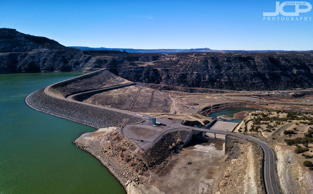 Navajo Lake on one side and the San Juan River on the other of Navajo Dam - DJI Mavic Pro drone image