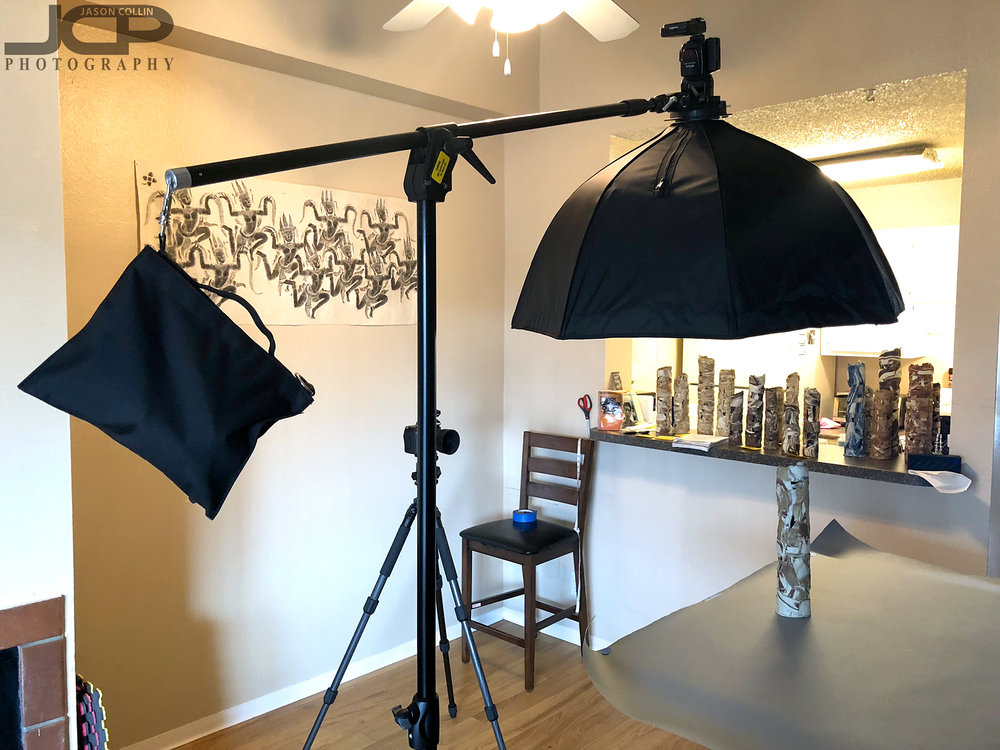 Behind the scenes of my art photography setup at my Home Studio. I used just one speedlight from above with a gray paper background hanging on a background stand.
