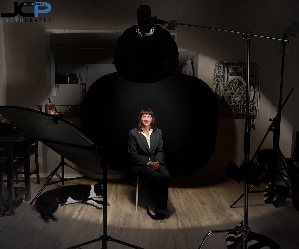 The capabilities of the JCP Hoe Studio for a creative and professional headshot shoot, this time using two strobes and a reflector with a standing black background in Albuquerque New Mexico.