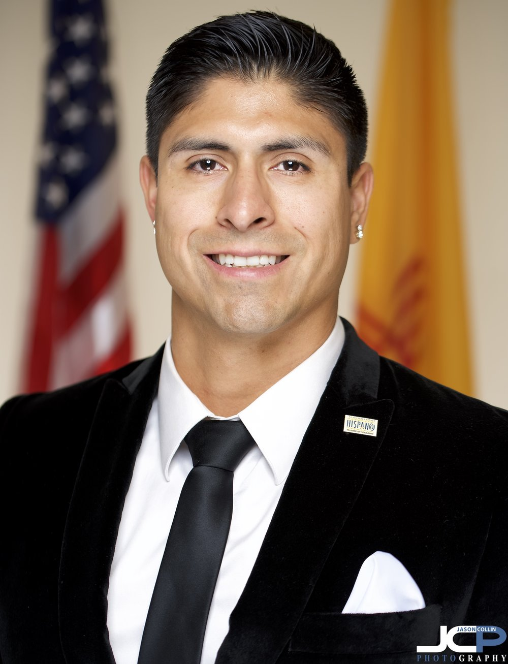 The U.S. and New Mexico flags make up the background for this series of headshots in Albuquerque