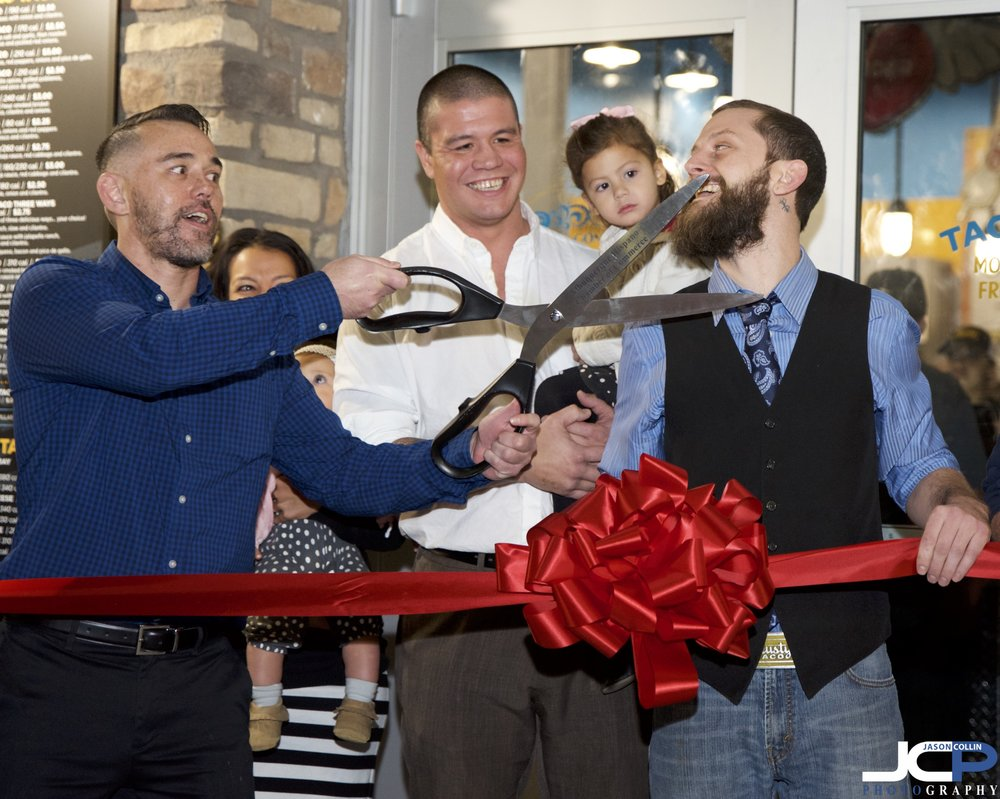 Be careful with those ceremonial scissors, they are still a little sharp! - professional event photography for ribbon cuttings in Albuquerque, New Mexico