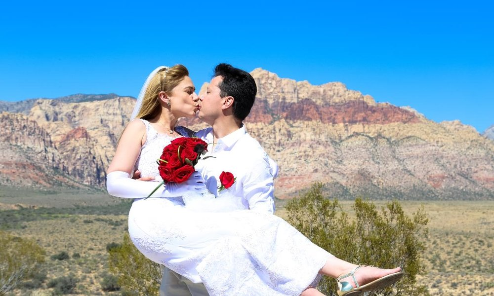 Red Rock - From $949.00InclusionsMinister, Professional photographer, Guide, Hotel pickup and drop-off (selected hotels only), HD Digital Video Recording of ceremony, Champagne toast for the couple, Video archive of ceremony (for 30 days), Limo service up to 4 hours (up to 6 people)Simply Red Rock Package - 75 digital images, 12-rose bouquet and boutonnière, 8