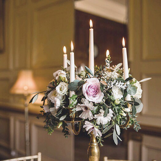 Flowers and candles - the perfect combination. Candelabras add the decoration without cluttering the surfaces, leaving more room for the wine bottles!