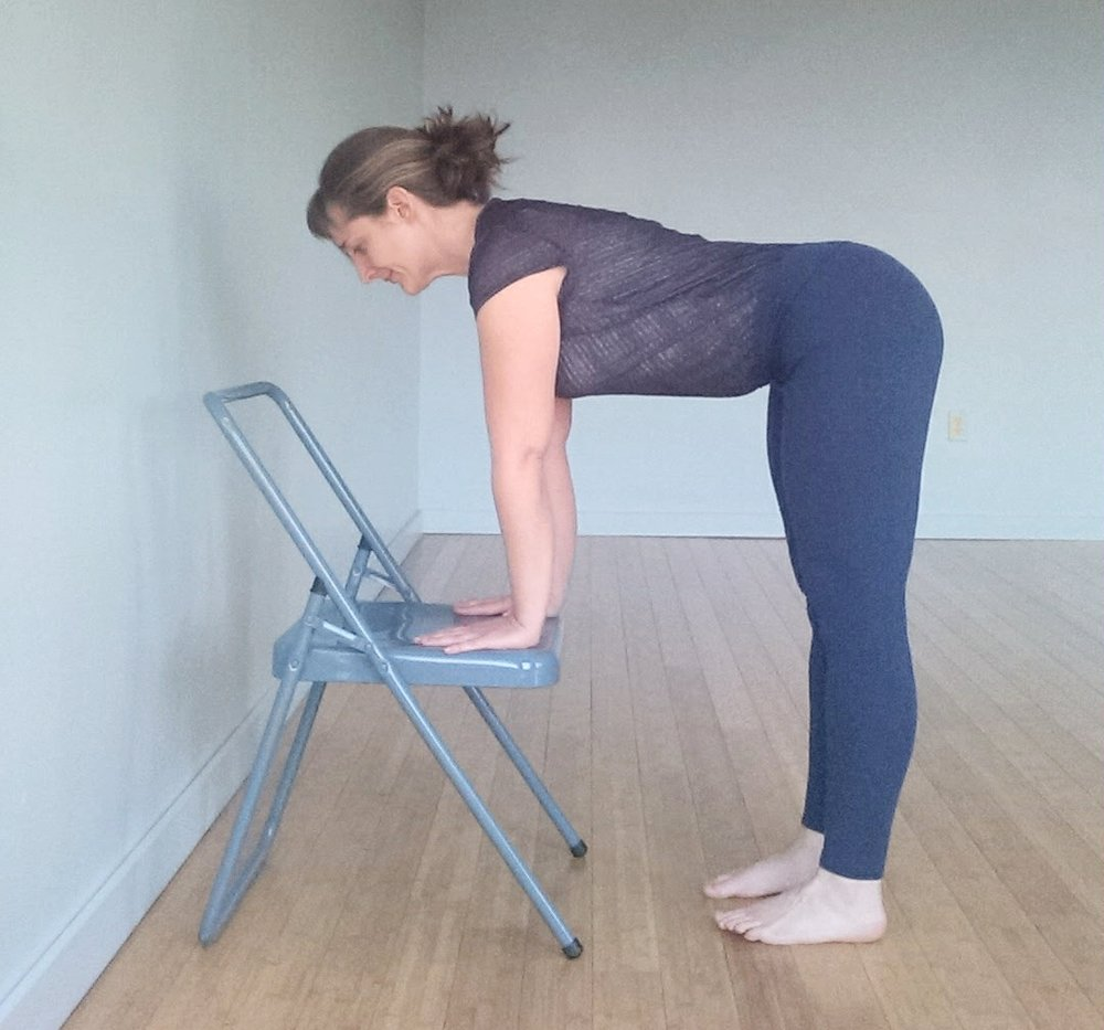 - Place your hands on the seat of a chair. Once you begin to increase the length of your hamstrings, start to work your hands closer to the floor to continue lengthening your hamstrings.Spread your feet 6-12 inches apart. Having your feet wide gives your pelvis more room to tilt forward.