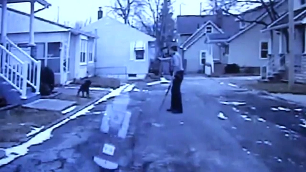 Of Dogs and Men - Sandusky, OH police officer takes aim at Lucy.jpg