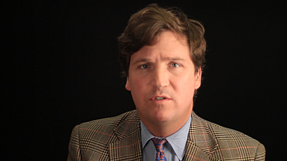 Of Dogs and Men - Tucker Carlson.jpg