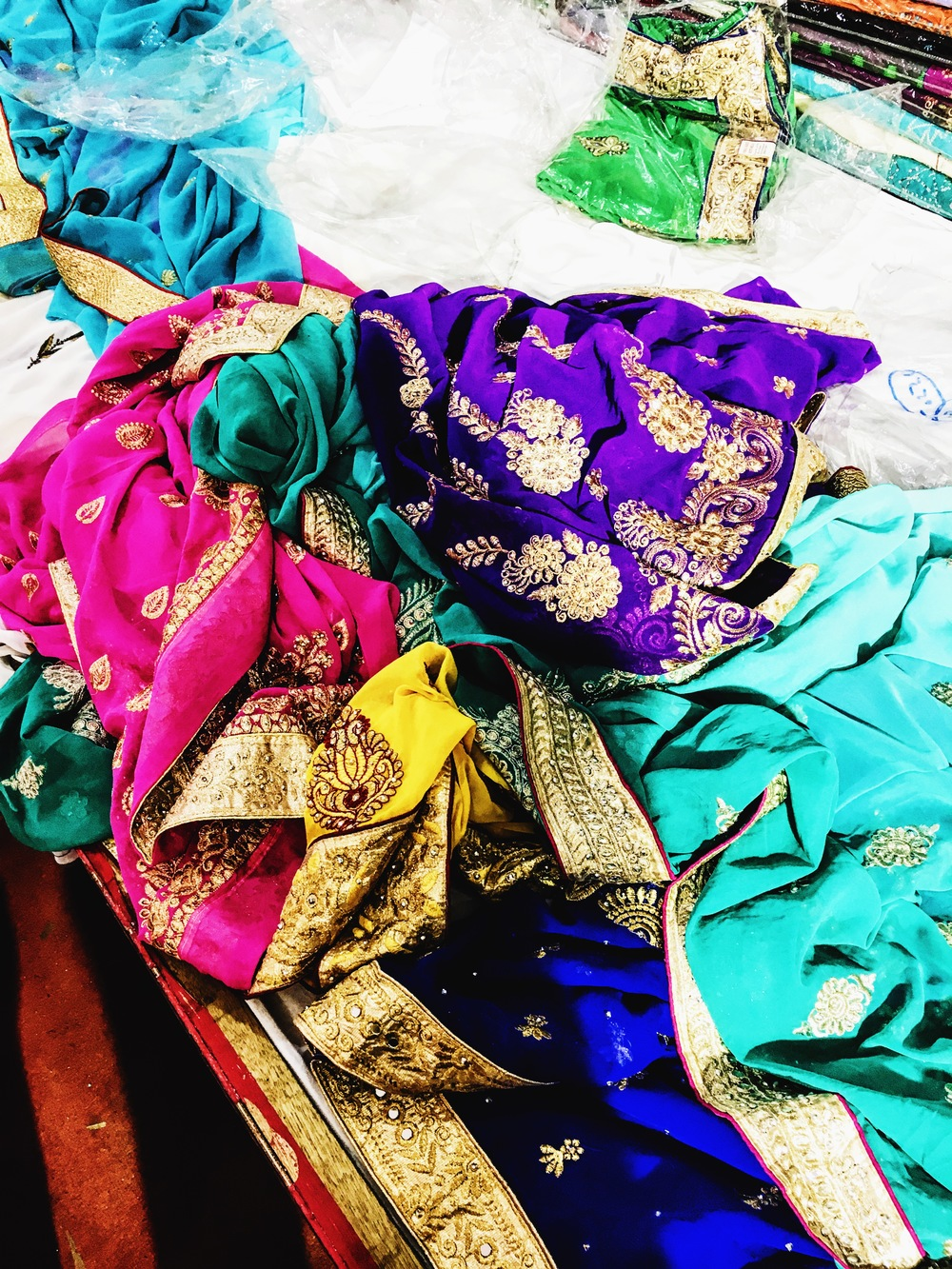 a colorful pile of saris we played dress up in (hehe oops)