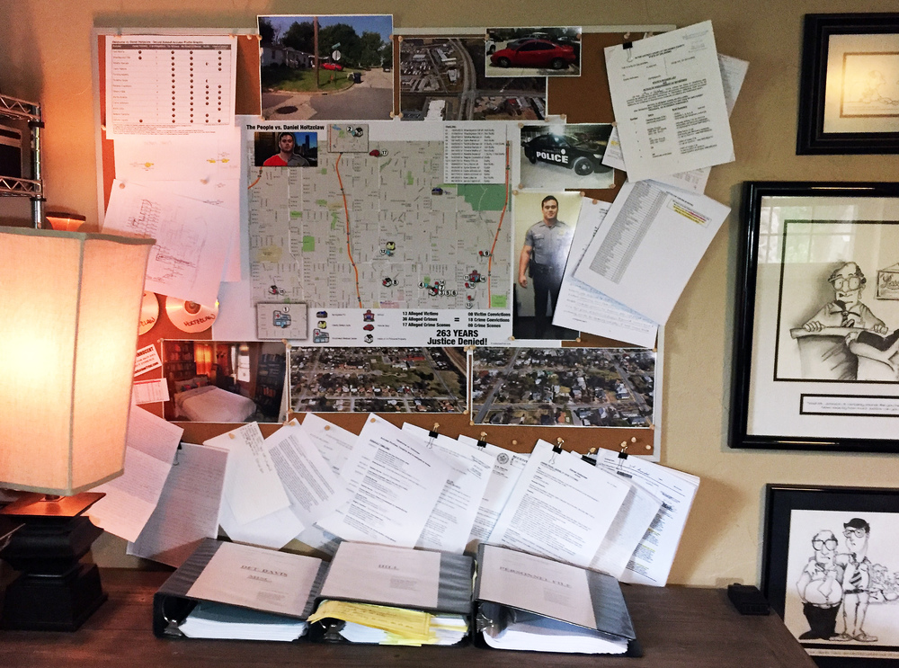 The 'war wall' in defense investigator Brian Bates' office.