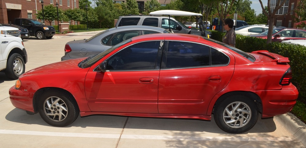 Photo of Jannie Ligons' 2004 red Pontiac Grand Am.
