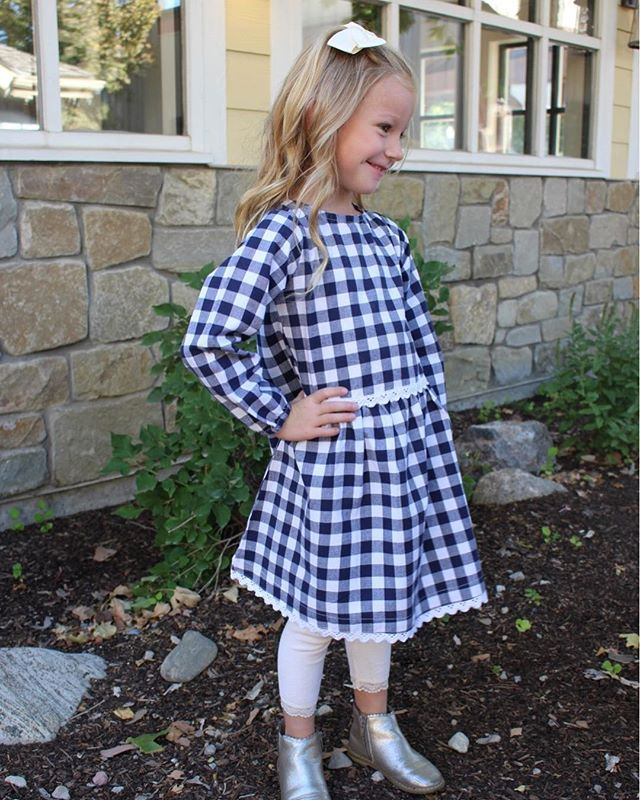 While they don't stay little for long, they will always stay in your heart. | Eloise Button Dress