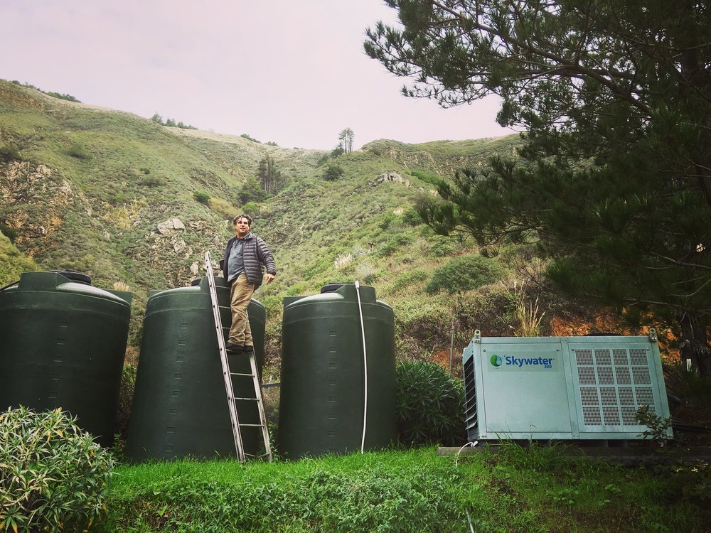 David Hertz harvesting water in Big Sur, California. Skywater 150 produces up to 150 gallons a day, and the water can be stored in water collection tanks for future use.