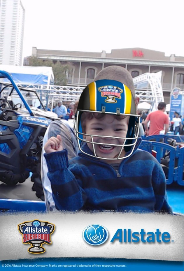 Child football fan wearing augmented reality football helmet
