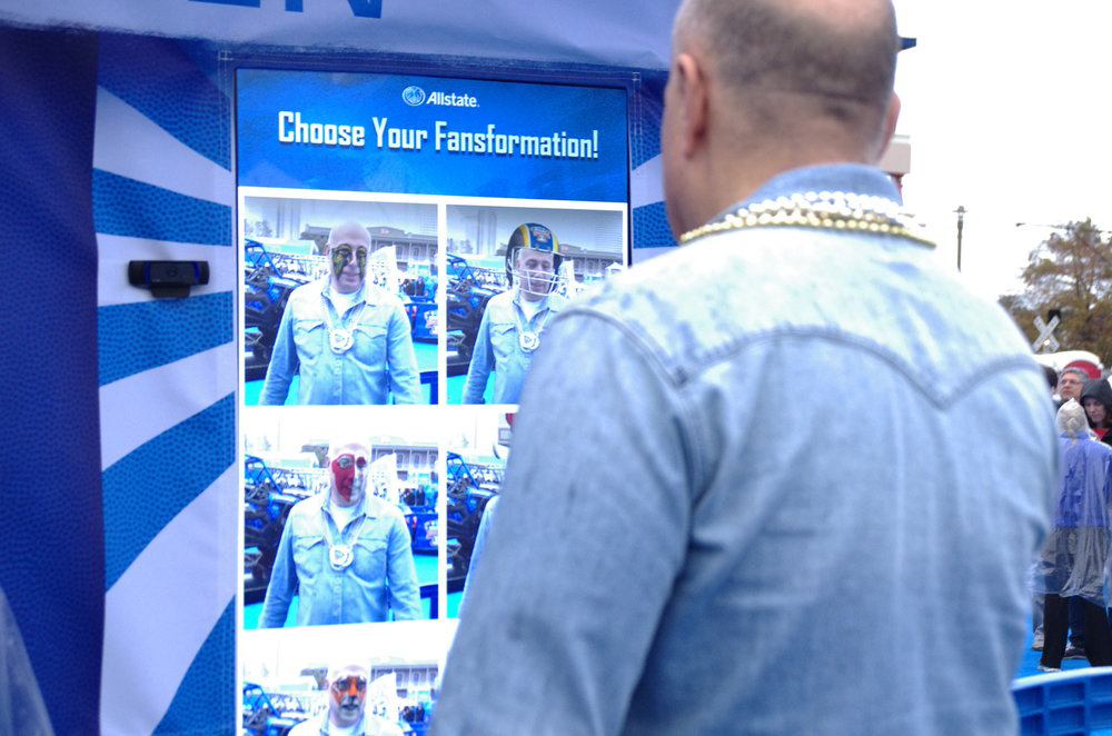 Man posing for augmented reality photo booth at Allstate college football activation