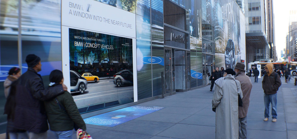 Viewers in front of an augmented reality window display created by Future Colossal