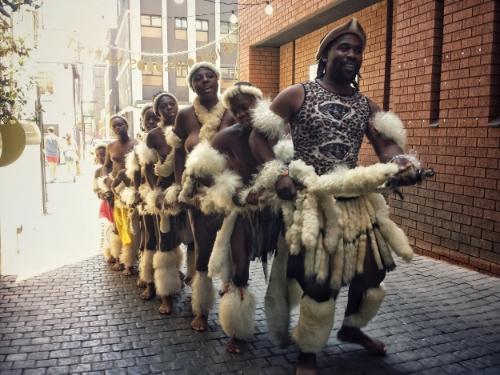 Zulu traditional dancers in The Neighbourgoods Market in Braamfontein, Johannesburg
