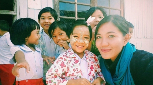 Rey with migrant children from the northern part of Thailand.