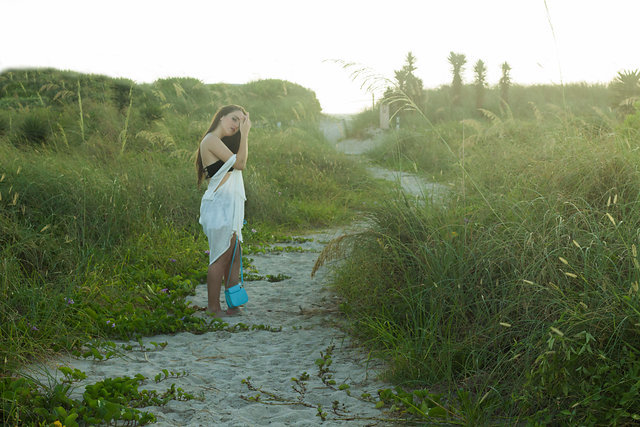 quince-photography-miami-bikini-open-field-quinceanera-young-girl-greenery-tall-grass-standing.jpg