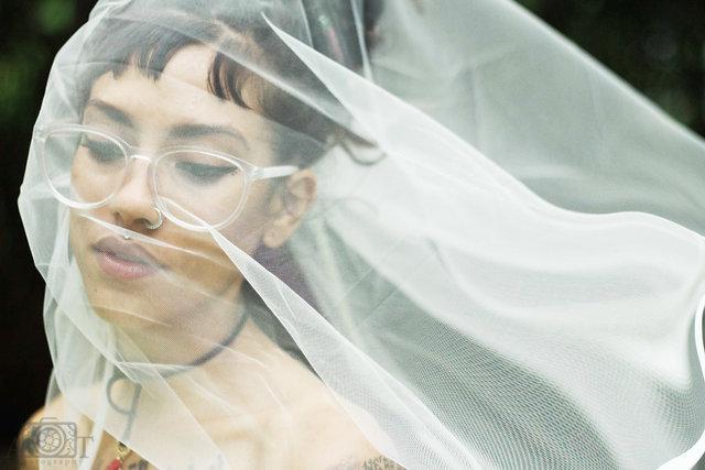 two-women-samesex-couple-lgbt-miami-michigan-wedding-photographer-2016-rustic-natural-hippie-lesbian portrait-veil-bride-portrait.jpg