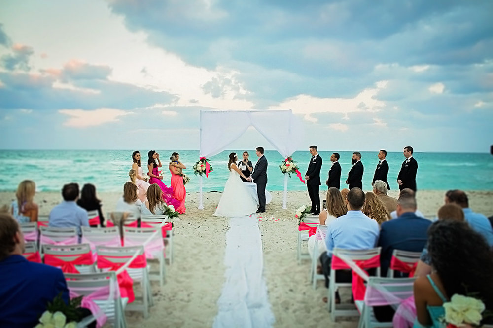 beach-wedding-ceremony-miami-california-white-pink-wedding-party-ribbon-chair-bride-groom-alter-los-angeles-photographer.jpg