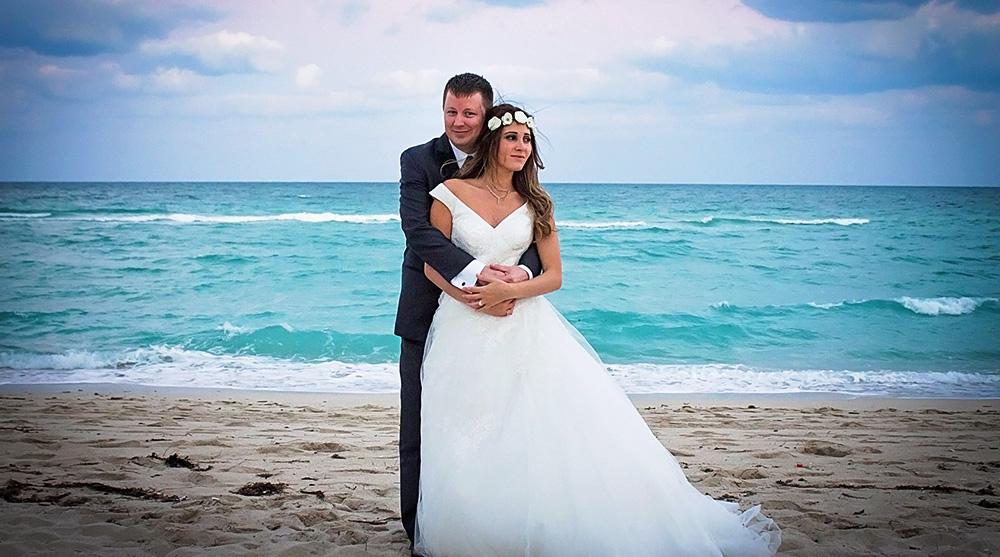bride-groom-portraits-couple-beach-white-dress-wedding-photographer-los-angeles-southern-california-elopment-blue-sky-ocean-sandy.jpg