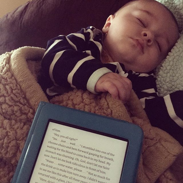 Sunday: when reading and cuddles are the very most important things.  Flowers for Algernon. Who's read it? #RowanWoodrow #5months #basically6months #butwhy #2oothy #newmama #nerd