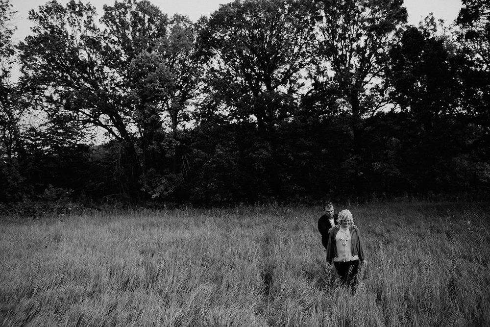 This photo was taken in September 2017, about three months after my husband fell off a roof and broke both his legs.  We didn't know our photographer was still shooting while we were hobbling through the grass.
